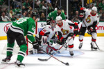 Dallas Stars right wing Corey Perry (10) attempts a shot on goal as Ottawa Senators defenseman Nikita Zaitsev (22) defends during the first period of an NHL hockey game in Dallas, Monday, Oct. 21, 2019. (AP Photo/Sam Hodde)