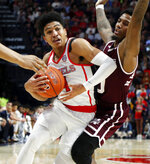 Mississippi guard Breein Tyree (4) pushes past Mississippi State guard Nick Weatherspoon (0) during the first half of an NCAA college basketball game in Oxford, Miss., Saturday, Feb. 2, 2019. (AP Photo/Rogelio V. Solis)