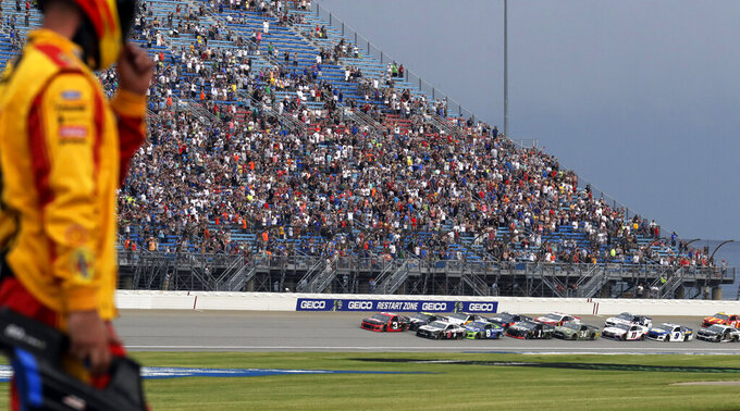 Drivers start a NASCAR Cup Series auto race at Chicagoland Speedway in Joliet, Ill., Sunday, June 30, 2019. (AP Photo/Nam Y. Huh)