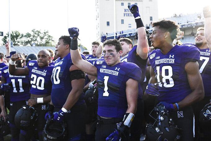 Northwestern players celebrate after an NCAA college football game against UNLV, Saturday, Sept. 14, 2019, in Evanston, Ill. Northwestern won 30-14. (AP Photo/Matt Marton)