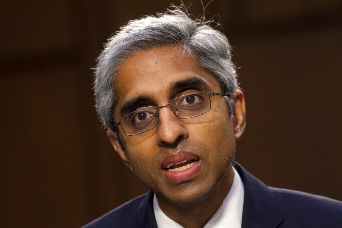 """FILE - In this Feb. 25, 2021 file photo, Vivek Murthy testifies before the Senate Health, Education, Labor, and Pensions committee on Capitol Hill in Washington. The nation's top doctor says it's """"certainly possible"""" that Americans eventually will be advised to get a booster shot of the coronavirus vaccine. Surgeon General Murthy told CNN that no decision had been made yet after a meeting Monday, July 12 with Pfizer to discuss its request for approval of a third shot of its coronavirus vaccine. (Caroline Brehman/Pool via AP, File)"""