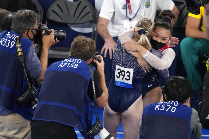 Sunisa Lee, of the United States, embraces teammate Jade Carey after winning the gold medal in the artistic gymnastics women's all-around final at the 2020 Summer Olympics, Thursday, July 29, 2021, in Tokyo. (AP Photo/Ashley Landis)