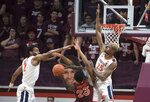 Virginia Tech guard Tyrece Radford (23) has his path to basket blocked by Virginia defenders Braxton Key (2) and Mamadi Diakite (25 ) during the first half of an NCAA college basketball game in Blacksburg, Va., Wednesday, Feb. 26, 2020. (AP Photo/Lee Luther Jr.)