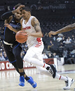 Saint Louis forward Hasahn French, left, guards Dayton forward Obadiah Toppin during the first half of an NCAA college basketball game in the Atlantic 10 Conference men's tournament Friday, March 15, 2019, in New York. (AP Photo/Mary Altaffer)