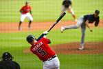 Atlanta Braves' Freddie Freeman lines out to right field on a pitch by Boston Red Sox pitcher Nick Pivetta, right, as Ozzie Albies plays off second base during the fifth inning of a baseball game Sunday, Sept. 27, 2020, in Atlanta. Boston won 9-1. (AP Photo/John Amis)