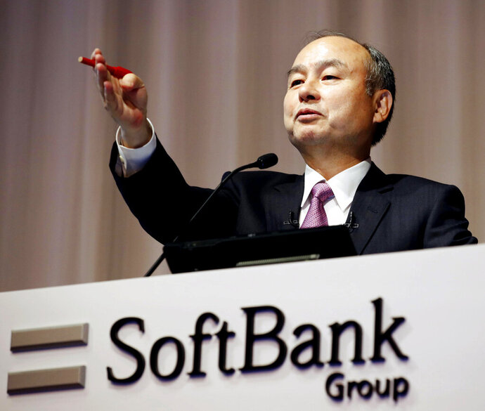 SoftBank founder and Chief Executive Officer Masayoshi Son speaks during a news conference in Tokyo Wednesday, Nov. 6, 2019. Japanese technology company SoftBank Group Corp. said Wednesday, it has tumbled into losses for the second quarter over money-losing investments, including a bailout for office-space sharing startup WeWork.(Kyodo News via AP)
