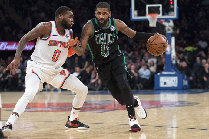 Boston Celtics guard Kyrie Irving (11) drives to the basket against New York Knicks guard Kadeem Allen (0) during the second half of an NBA basketball game Friday, Feb. 1, 2019, at Madison Square Garden in New York. The Celtics won 113-99. (AP Photo/Mary Altaffer)