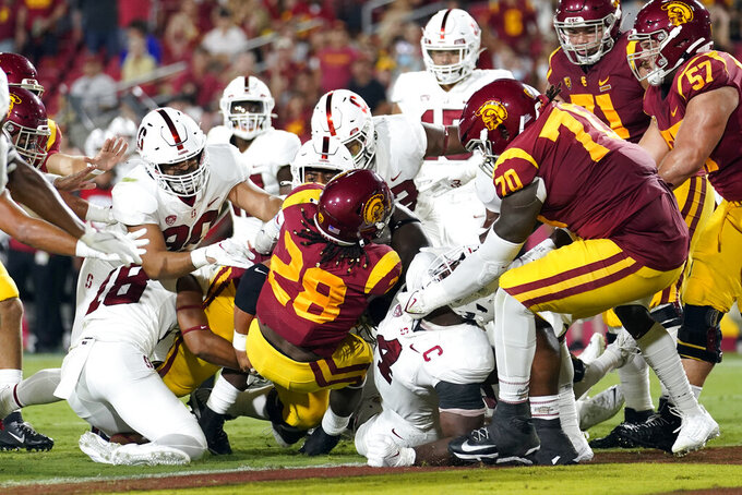 Southern California running back Keaontay Ingram (28) scores a rushing touchdown during the first half of the team's NCAA college football game against Stanford on Saturday, Sept. 11, 2021, in Los Angeles. (AP Photo/Marcio Jose Sanchez)