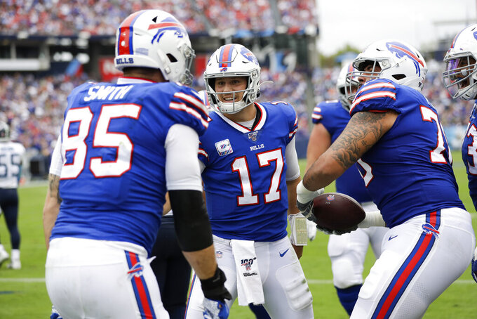 Buffalo Bills quarterback Josh Allen (17) celebrates with tight end Lee Smith (85) after they teamed up for an 8-yard touchdown pass against the Tennessee Titans in the first half of an NFL football game Sunday, Oct. 6, 2019, in Nashville, Tenn. (AP Photo/James Kenney)