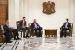 In this photo released by Russian Foreign Ministry Press Service, Russian Foreign Minister Sergey Lavrov, left, and Syrian President Bashar al-Assad, right, attend talks in Damascus, Syria, Monday, Sept. 7, 2020. Russia's foreign minister has met with Syrian President Bashar Assad shortly after landing in the Syrian capital on his first visit since 2012. Russia has been a close ally of Assad in Syria's long and bloody nine-year-long civil war, lending his government in Damascus vital military, economic and political support. (Russian Foreign Ministry Press Service via AP)