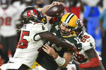 Tampa Bay Buccaneers inside linebacker Devin White (45) sacks Green Bay Packers quarterback Aaron Rodgers (12) during the second half of an NFL football game Sunday, Oct. 18, 2020, in Tampa, Fla. (AP Photo/Jason Behnken)