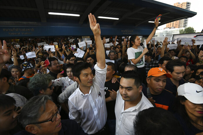 Thailand's Future Forward Party leader Thanathorn Juangroongruangkit gestures as he talks to his supporters during rally in Bangkok, Thailand, Saturday, Dec. 14, 2019. Several thousand supporters of a popular Thai political party, under threat of dissolution, packed a concourse in central Bangkok on Saturday in one of the largest political demonstrations in recent years. (AP Photo/Str)