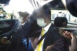 Solicitor Trevor Chan, lawyer of Hong Kong pro-democracy activist Andy Li, leaves a court in Hong Kong, Wednesday, April 7, 2021. Li is one of the 12 young pro-democracy activists captured at sea last year by mainland Chinese authorities and returned to Hong Kong in March, as Li is charged with an offense under the newly-invented National Security Law. (AP Photo/Kin Cheung)