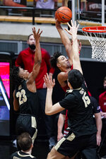Indiana forward Trayce Jackson-Davis (23) is fouled as he gets a dunk over Purdue center Zach Edey (15) during the second half of an NCAA college basketball game in West Lafayette, Ind., Saturday, March 6, 2021. (AP Photo/Michael Conroy)