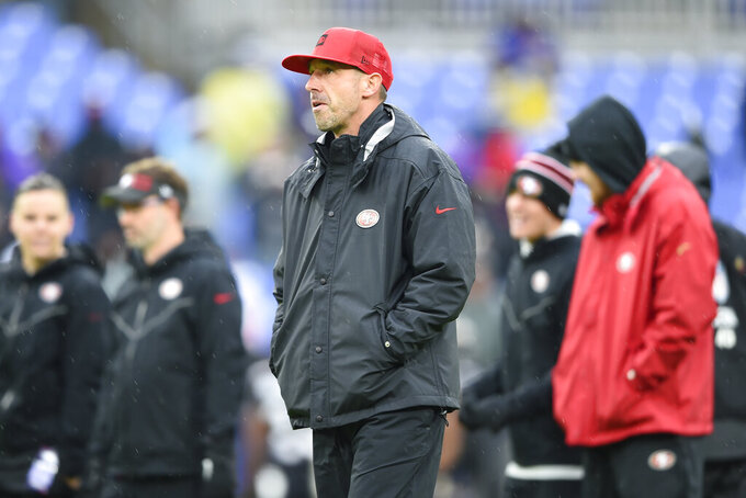 San Francisco 49ers head coach Kyle Shanahan walks on the field before the start of the first half of an NFL football game against the Baltimore Ravens, Sunday, Dec. 1, 2019, in Baltimore, Md. (AP Photo/Gail Burton)