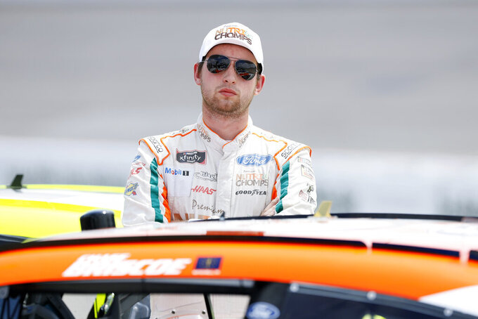 Chase Briscoe watches qualifying for a NASCAR Xfinity Series auto race, Sunday, June 16, 2019, at Iowa Speedway in Newton, Iowa. (AP Photo/Charlie Neibergall)