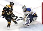 Boston Bruins' Brad Marchand, left, can't get the puck past St. Louis Blues goaltender Jordan Binnington during the first period in Game 5 of the NHL hockey Stanley Cup Final, Thursday, June 6, 2019, in Boston. (AP Photo/Charles Krupa)