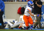 Air Force defensive back Ross Connors, left, pulls down Boise State wide receiver Sean Modster in the first half of an NCAA college football game Saturday, Oct. 27, 2018, at Air Force Academy, Colo. (AP Photo/David Zalubowski)
