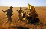 FILE - This July 29, 2017 file photo, Hezbollah fighters stand near a four-wheel vehicle positioned at the site where clashes erupted between Hezbollah and al-Qaida-linked fighters in Wadi al-Kheil on the Lebanon-Syria border. From Lebanon and Syria to Iraq, Yemen, and the Gaza Strip, Iran has significantly expanded its footprint over the past decade, finding and developing powerful allies in conflict-ravaged countries across the Middle East. Iran has used groups like the Lebanese Hezbollah to strike its regional foes, and could mobilize them if the latest tensions with the United States lead to an armed conflict, dramatically expanding the battlefield. (AP Photo/Bilal Hussein, File)