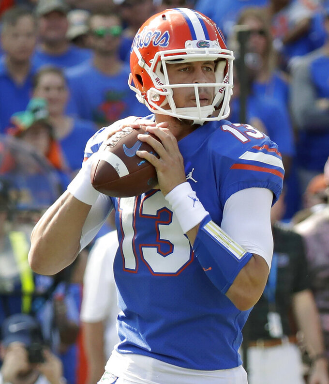FILE - In this Oct. 6, 2018, file photo, Florida quarterback Feleipe Franks looks for a receiver against LSU during the first half of an NCAA college football game in Gainesville, Fla. Florida and Miami have the college football stage to themselves for 3 ½ hours Saturday, a new chapter in their once-heated and forever-storied rivalry. (AP Photo/John Raoux, File)