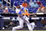 New York Mets' Javier Baez strikes out swinging during the first inning of a baseball game against the Miami Marlins, Thursday, Aug. 5, 2021, in Miami. (AP Photo/Lynne Sladky)