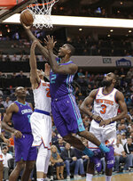 Charlotte Hornets' Marvin Williams (2) drives against New York Knicks' Kevin Knox (20) during the first half of an NBA basketball game in Charlotte, N.C., Monday, Jan. 28, 2019. (AP Photo/Chuck Burton)