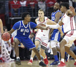 Eastern Illinois guard Marvin Johnson (4) looks for a lane against the defense of Wisconsin guard Brevin Pritzl (1) and forward Aleem Ford (2) during the first half of an NCAA college basketball game in Madison, Wis., Friday, Nov. 8, 2019. (John Hart/Wisconsin State Journal via AP)
