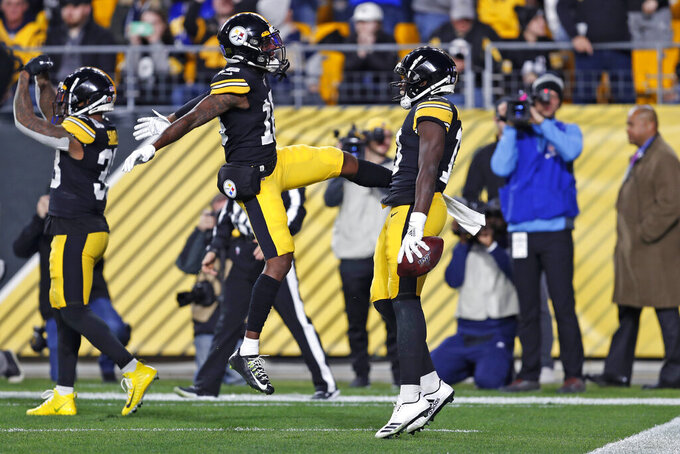 Pittsburgh Steelers wide receiver James Washington, right, celebrates his touchdown catch with Diontae Johnson (18) during the first half of the team's NFL football game against the Los Angeles Rams in Pittsburgh, Sunday, Nov. 10, 2019. (AP Photo/Keith Srakocic)