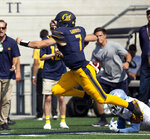 California quarterback Chase Garbers (7) eludes the tackle of North Carolina cornerback Patrice Rene (5) during the second half of an NCAA college football game, Saturday, Sept. 1, 2018, in Berkeley, Calif. Cal won 24-17. (AP Photo/D. Ross Cameron)