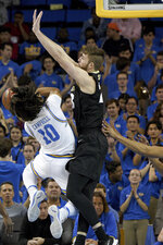 UCLA guard Tyger Campbell (10) tries to shoot over Colorado forward Lucas Siewert during the first half of an NCAA college basketball game Thursday, Jan. 30, 2020, in Los Angeles. (AP Photo/Michael Owen Baker)