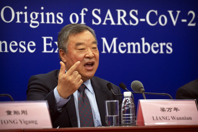 Liang Wannian, the Chinese co-leader of the joint China-WHO investigation into the origins of the COVID-19 pandemic, speaks during a press conference in Beijing, Wednesday, March 31, 2021. Chinese health officials pushed Wednesday for expanding the search for the origins of COVID-19 beyond China, one day after the release of a World Health Organization report on the issue. (AP Photo/Mark Schiefelbein)