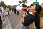 Demonstration co-organizer Sanah Niaci uses a megaphone during a protest, Saturday, June 6, 2020, in Simi Valley, Calif. over the death of George Floyd. Protests continue throughout the country over the death of Floyd, a black man who died after being restrained by Minneapolis police officers on May 25 (AP Photo/Mark J. Terrill)