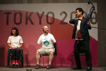 "Joined by Paralympian Monika Seryu, left, and comedian Ryota Yamasato, armless archer Matt Stutzman attends an event held to unveil tickets for the Tokyo 2020 Olympics and Paralympics Wednesday, Jan. 15, 2020, in Tokyo. Stutzman has become famous and known as the ""Armless Archer."" Stutzman won a silver medal in the 2012 London Paralympics and will be among the favorites in archery this year in Tokyo. (AP Photo/Jae C. Hong)"