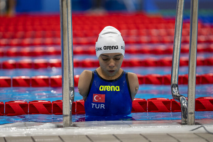 Sevilay Ozturk, from Turkey, leaves the pool after competing at Women's 200m Freestyle - S5 Heat 1 at the Tokyo Aquatics Centre during the Tokyo 2020 Paralympic Games, Wednesday, Aug. 25, 2021, in Tokyo, Japan. (AP Photo/Emilio Morenatti)