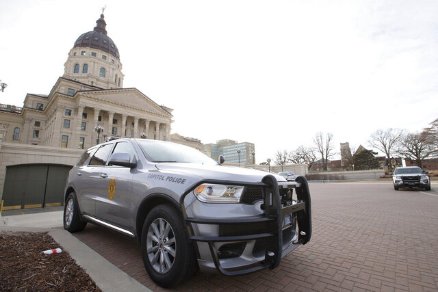 Capitol Police vehicles with the Kansas Highway Patrol sit parked outside the Kansas Statehouse Thursday afternoon, Jan. 14, 2021, in Topeka, Kan. Gov. Laura Kelly is restricting access to the Kansas Statehouse over the possibility of an armed protest in the coming week. (Evert Nelson/The Topeka Capital-Journal via AP)