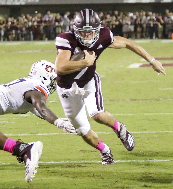 Mississippi State quarterback Nick Fitzgerald (7) sprints past Auburn defender Deshaun Davis (57) and into the end zone for a touchdown during the first half of their NCAA college football game on Saturday, Oct. 6, 2018, in Starkville, Miss. (AP Photo/Jim Lyle)