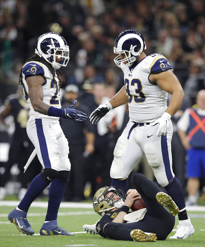 Los Angeles Rams nose tackle Ndamukong Suh (93) is congratulated after sacking New Orleans Saints' Drew Brees during the first half the NFL football NFC championship game, Sunday, Jan. 20, 2019, in New Orleans. (AP Photo/Carolyn Kaster)