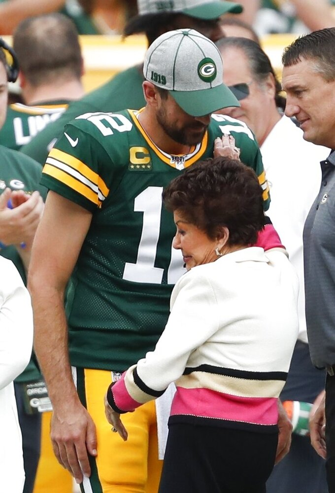Cherry Louise Morton, wife of former Green Bay Packers Bart Starr is hugged by Aaron Rodgers during halftime of an NFL football game Sunday, Sept. 15, 2019, in Green Bay, Wis. (AP Photo/Matt Ludtke)