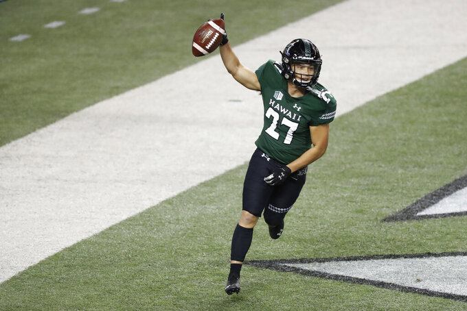 Hawaii running back Koali Nishigaya (27) reacts after making a touchdown against UNLV in the second half of an NCAA college football game Saturday, Dec. 12, 2020, in Honolulu. (AP Photo/Marco Garcia)