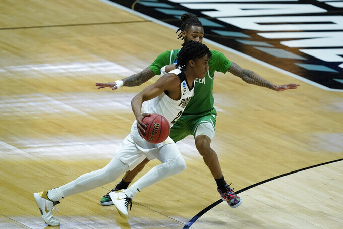 Purdue's Jaden Ivey (23) goes to the basket against North Texas's James Reese (0) during the first half of a first-round game in the NCAA men's college basketball tournament at Lucas Oil Stadium, Friday, March 19, 2021, in Indianapolis. (AP Photo/Darron Cummings)