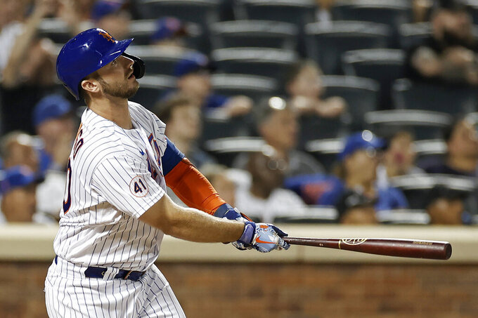 New York Mets' Pete Alonso watches his home run against the Toronto Blue Jays during the eighth inning of a baseball game Friday, July 23, 2021, in New York. (AP Photo/Adam Hunger)
