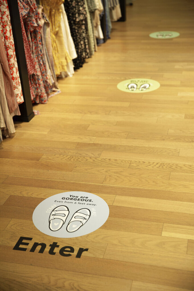 In this photo provided by American Eagle Outfitters, social distance markers are shown at Cranberry Mall American Eagle Store in Cranberry, Pa. (Ross Ribblett/American Eagle Outfitters, Inc. via AP)