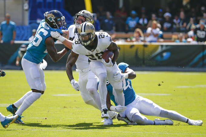 New Orleans Saints running back Latavius Murray (28) is stopped by Jacksonville Jaguars middle linebacker Myles Jack, right, and defensive back Jarrod Wilson, left, during the first half of an NFL football game, Sunday, Oct. 13, 2019, in Jacksonville, Fla. (AP Photo/Stephen B. Morton)
