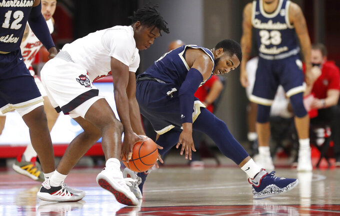 North Carolina State's Cam Hayes (3) steals the ball from Charleston Southern's Travis Anderson (0) during the first half in an NCAA college basketball game in Raleigh, N.C., Wednesday, Nov. 25, 2020. (Ethan Hyman/The News & Observer via AP)