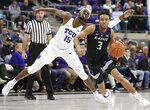 Kansas State guard Kamau Stokes (3) gets through the defense of TCU forward JD Miller (15) on a drive to the basket in the first half of an NCAA college basketball game in Fort Worth, Texas, Monday, March 4, 2019. (AP Photo/Tony Gutierrez)