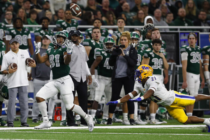 Eastern Michigan wide receiver Quian Williams (81), defended by Pittsburgh defensive back Damarri Mathis (21), catches a pass and runs for 50-yards for a touchdown during the first half of the Quick Lane Bowl NCAA college football game, Thursday, Dec. 26, 2019, in Detroit. (AP Photo/Carlos Osorio)