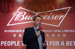 Jan Craps, Executive Director and CEO of Budweiser Brewing Company APAC Limited speaks during a press conference in Hong Kong, Tuesday, Sept. 17, 2019. AB InBev, the world's largest brewer that produces Budweiser and Corona, has revived plans to list its Asian business in Hong Kong despite persistent pro-democracy protests but halved the size of its initial public offering. (AP Photo/Vincent Yu)