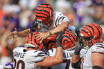 Cincinnati Bengals kicker Evan McPherson (2) is lifted by teammates after hitting a field goal to defeat the Minnesota Vikings during overtime of an NFL football game, Sunday, Sept. 12, 2021, in Cincinnati. The Bengals won 27-24. (AP Photo/Aaron Doster)
