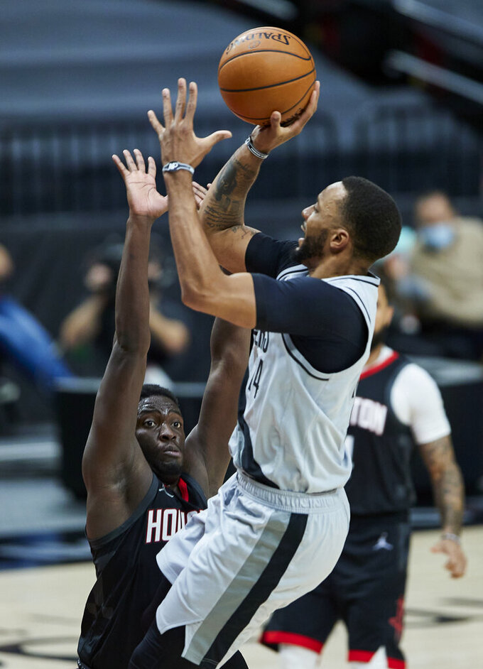 Portland Trail Blazers forward Norman Powell, right, shoots over Houston Rockets forward Khyri Thomas during the second half of an NBA basketball game in Portland, Ore., Monday, May 10, 2021. (AP Photo/Craig Mitchelldyer)