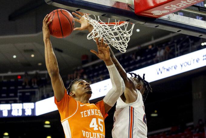 Tennessee guard Keon Johnson (45) puts up a shot as Auburn guard Allen Flanigan (22) tries to block during the second half of an NCAA basketball game Saturday, Feb. 27, 2021, in Auburn, Ala. Auburn won 77-72. (AP Photo/Butch Dill)